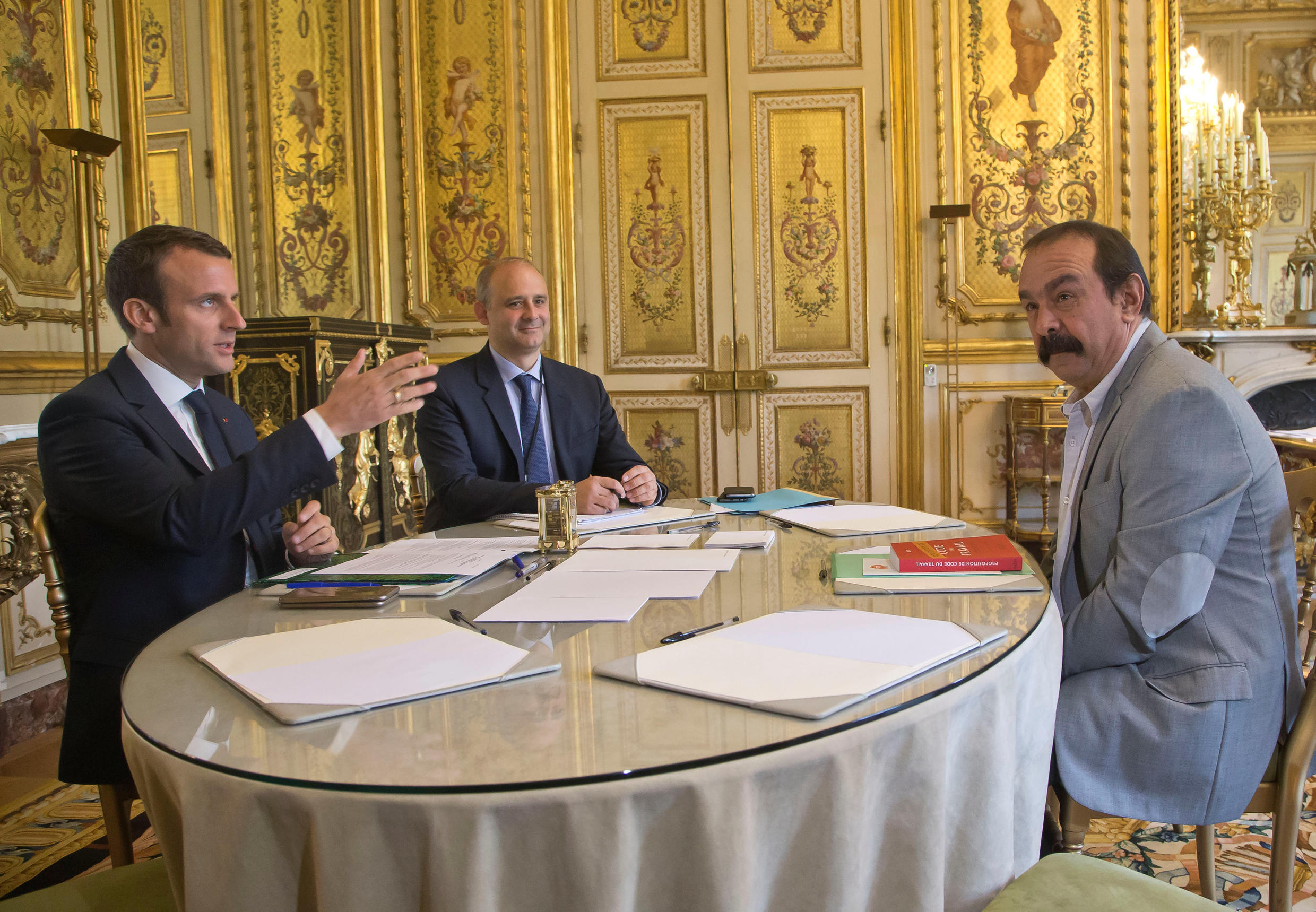French President Emmanuel Macron (L) meets with CGT labour union leader Philippe Martinez at the Elysee Palace in Paris, France, May 23, 2017.