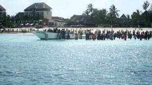 Zanzibaris flock to the shore to await news of ferry disaster