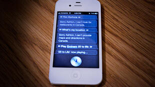Machines and software are increasingly replacing human functions, such as the Siri application on Apple's iPhones.