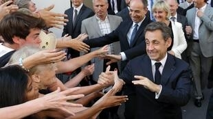 Nicolas Sarkozy arrives at UMP headquarters in Paris on Monday