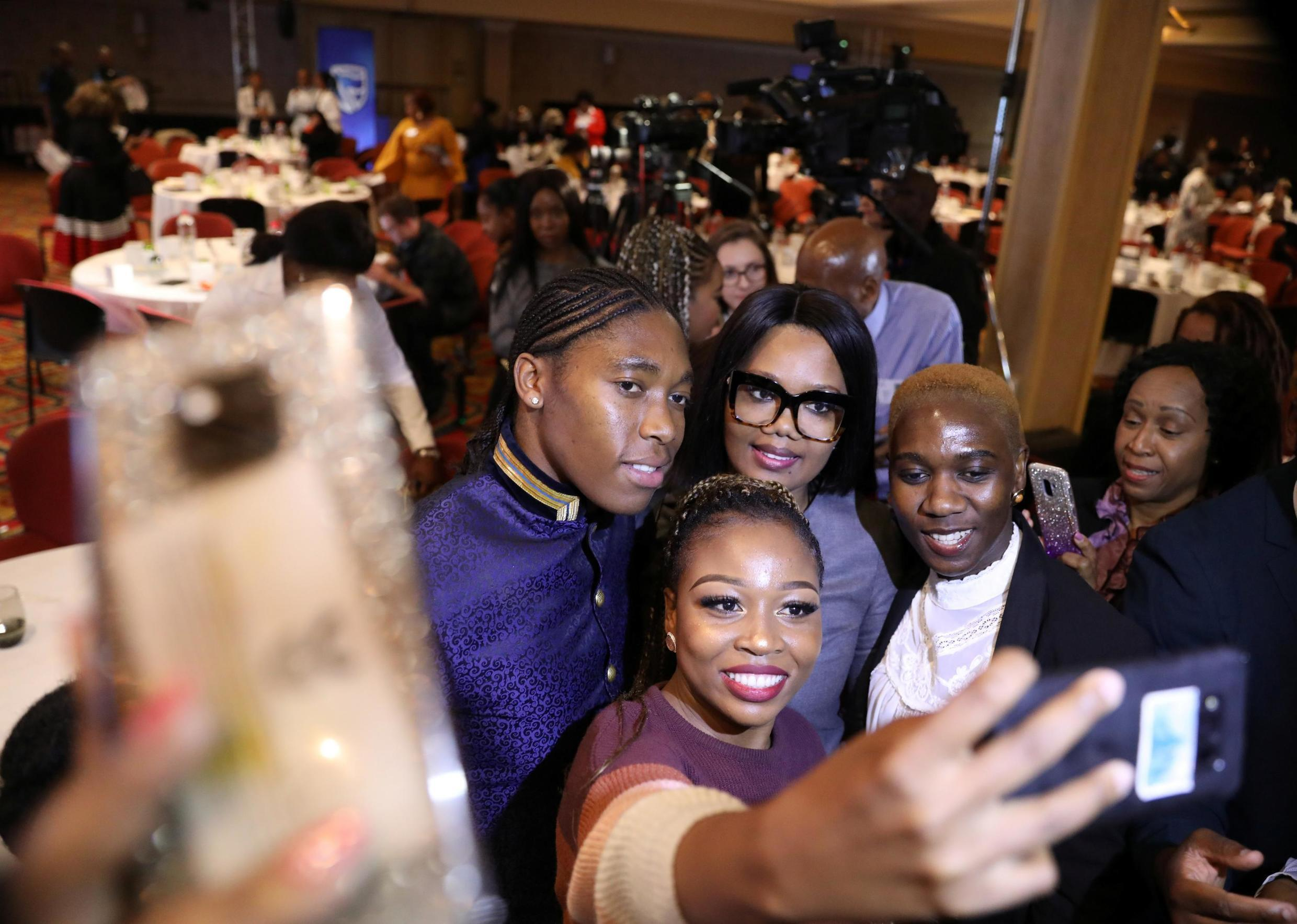South African athlete Caster Semenya takes selfies with fans at a the Top Women conference in Johannesburg, South Africa 14 August 2019.