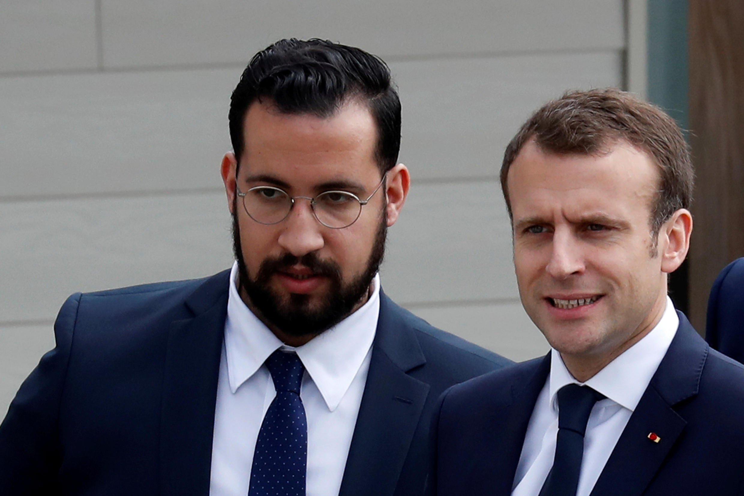 Macron and his then senior security officer Alexandre Benalla arrive at an elementary school to attend a one-hour interview with French news channel TF1, in Berd'huis, France, April 12, 2018. Picture taken April 12, 2018.