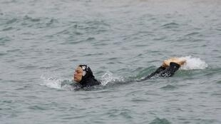 A woman in a burkini swims in the Medterranean off Marseille