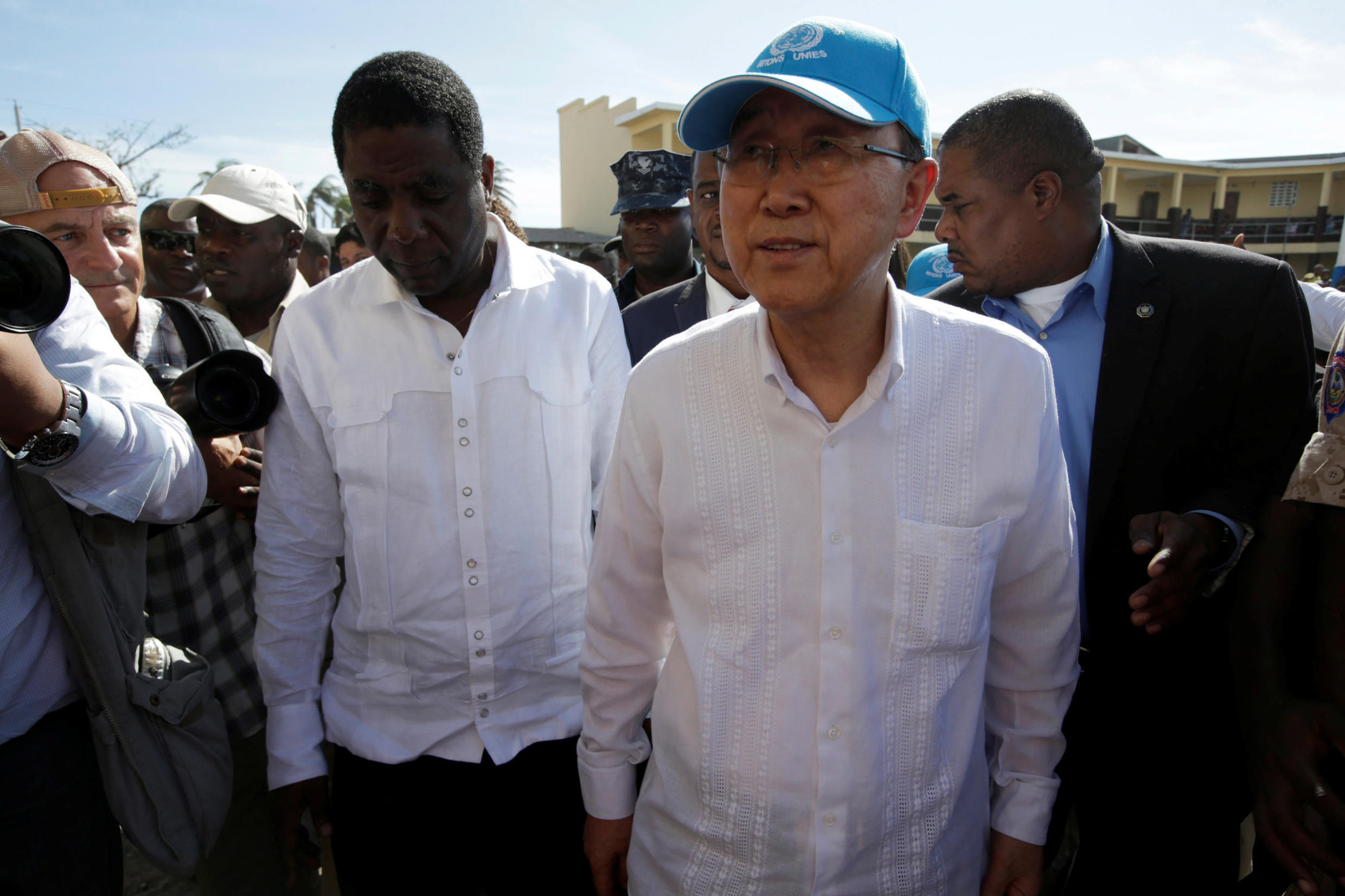 """UN Secretary-General Ban Ki-moon (seen here, right, on 15 October, 2016 in Haiti) says there is """"no plan B"""" for climate change."""