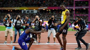 Justin Gatlin hails Usain Bolt after winning the men's 100 metres final.