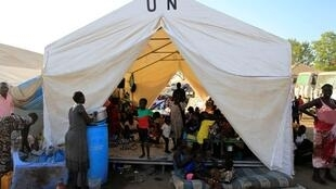 Displaced people stay in makeshift tents inside Tomping United Nations base near Juba international airport, where some 12,000 people from the Nuer tribe have sought refuge at, December 24, 2013.