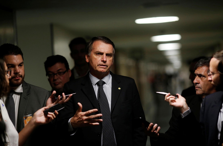 Le candidat à la présidentielle et député Jair Bolsonaro arrive au Congrès, à Brasilia, le 7 août 2018.
