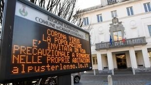 A sign warning people to stay at home is seen in the town of Casalpusterlengo amid a coronavirus outbreak in northern Italy, February 22, 2020.