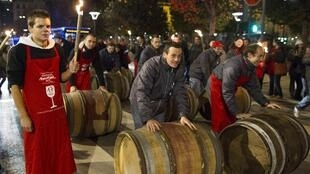 Barrels of Beujolais Noveau are rolled out in Lyon early Thursday morning