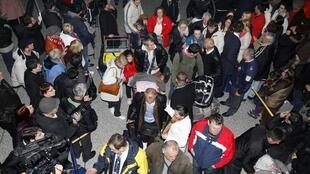 Passengers fleeing unrest in Libya arrive from the Libyan capital city of Tripoli to Sarajevo Airport, 25 February 2011