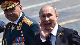 Putin (R) sent Shoigu (L) birthday greetings and signed a decree awarding him one of Russia's highest decorations