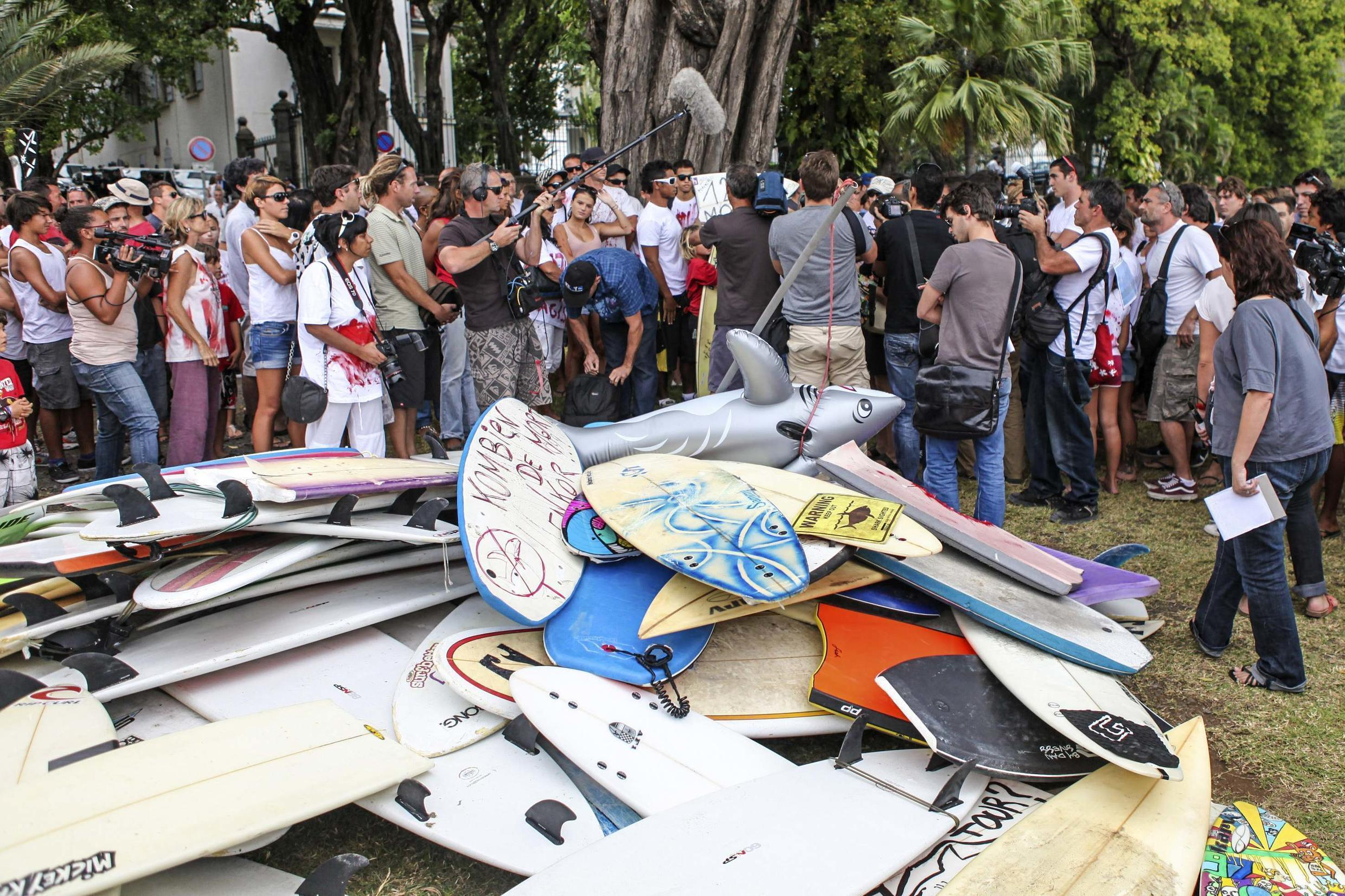 Surfboards are stacked on the ground during demonstration on the Island of La Réunion after Alexandre Rassica died following a shark attack where the animal bit off his leg while surfing