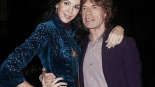 Mick Jagger (L) with L'Wren Scott in 2012