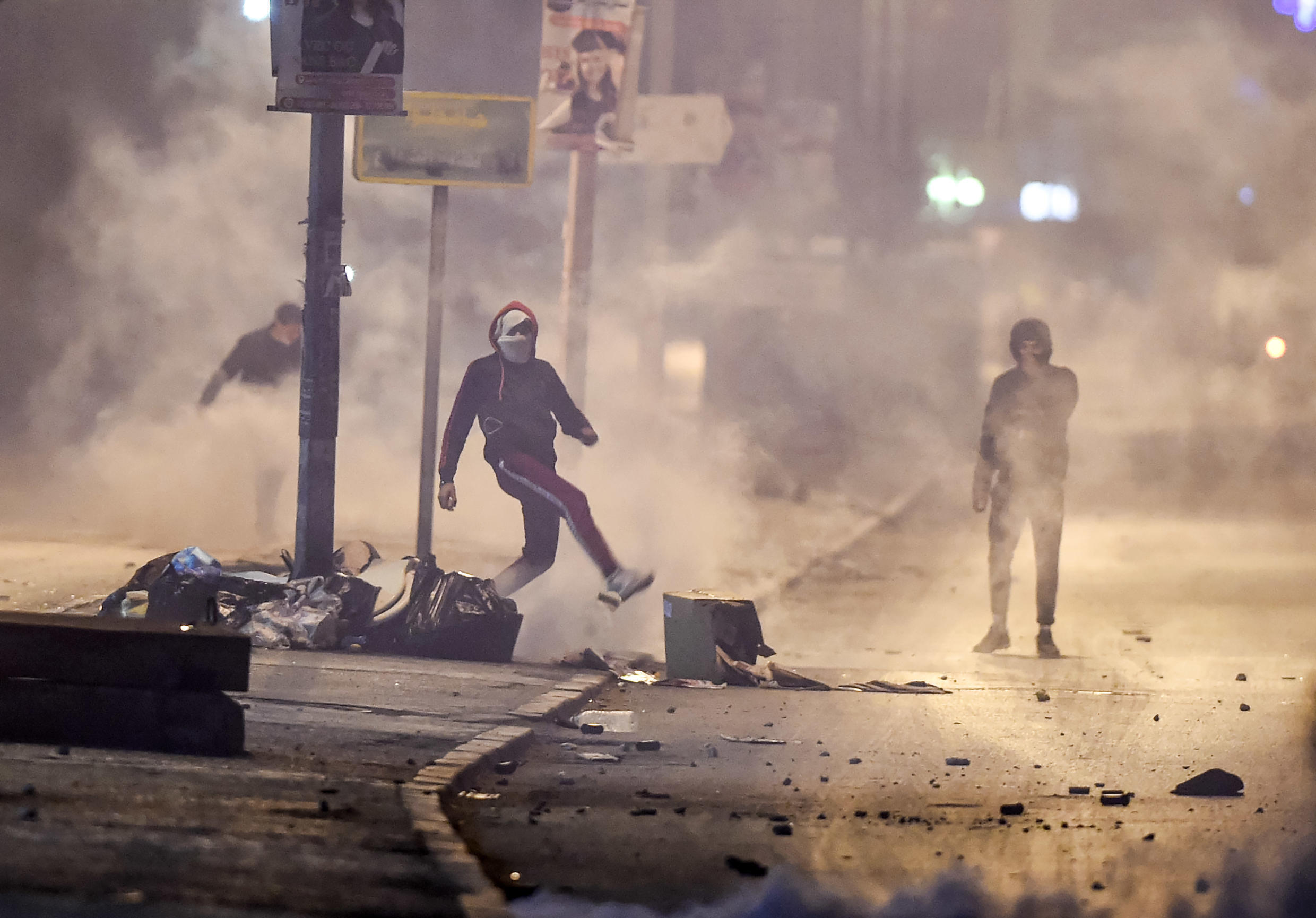 Tunisian protesters defy lockdown orders as they clash with security forces in the Ettadhamen suburb of Tunis