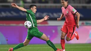 Chasing shadows: Kim Young-gwon, one of South Korea's scorers, skips past Annadurdyyev Altymyrat of Turkmenistan