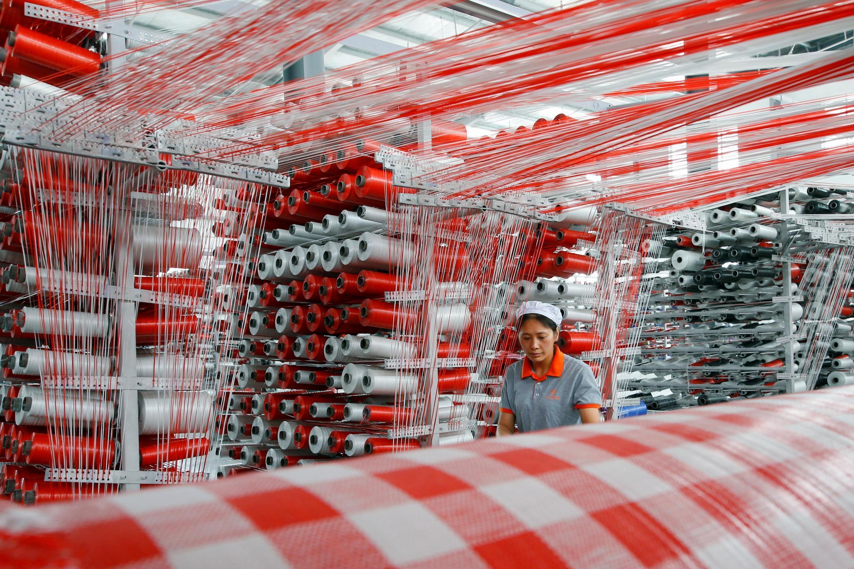 Usine de production d'emballages plastique à Suqian, province du Jiangsu, en Chine le 13 juillet 2019.