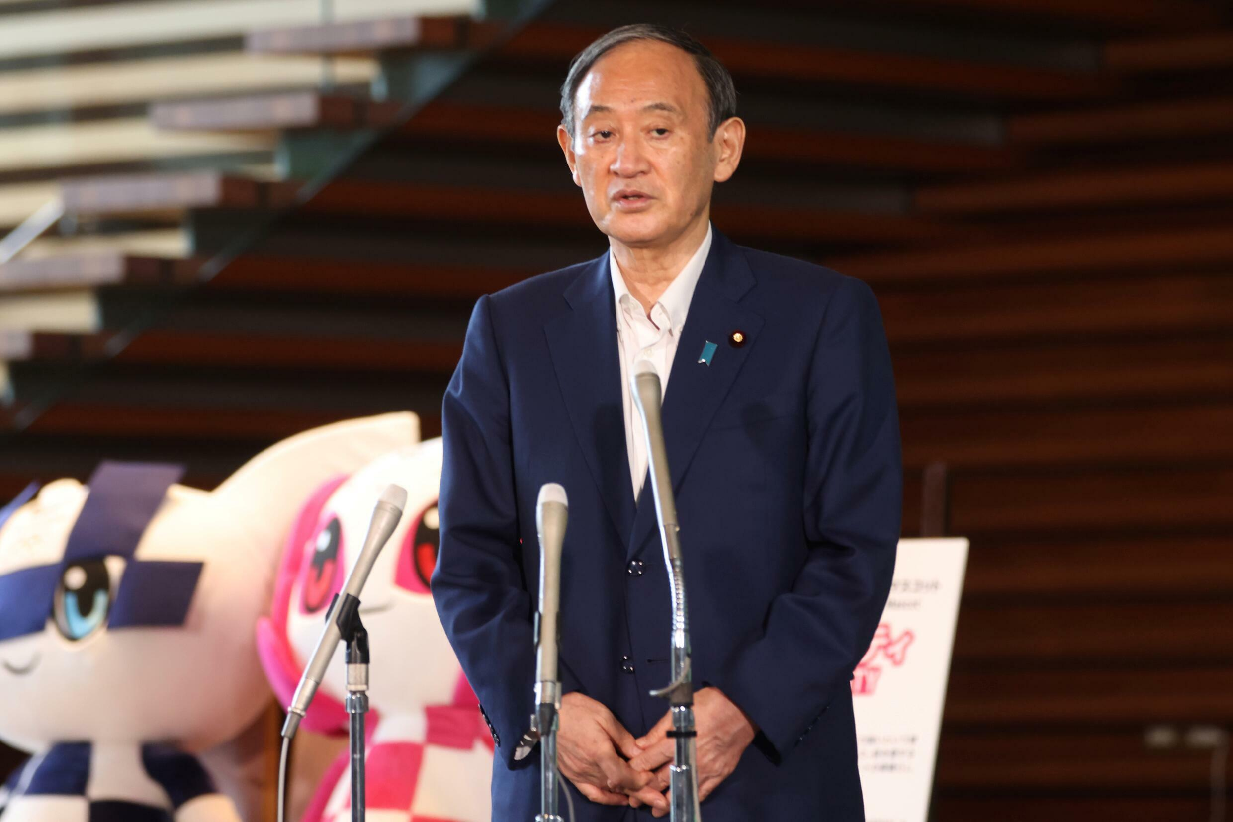 Japan's Prime Minister Yoshihide Suga said he realised that running for election and handling the virus response would require 'enormous energy'