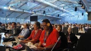 Des déléguées des Iles Cooks, le vendredi 12 décembre, à Lima. Les petites îles sont les premières à s'opposer aux pays industriels, sur la participation aux contributions à la lutte contre le changement climatique.