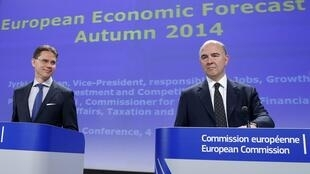 European Commissioners Jyrki Katainen and Pierre Moscovici, Brussels, 4 November 2014.