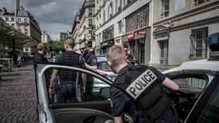 French police officers of the CSI unit patrol in the streets of Paris on June 30, 2016.