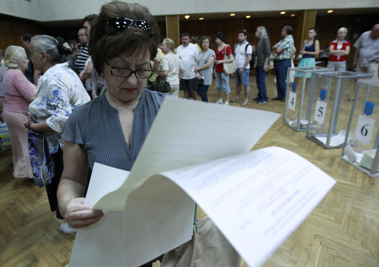 Dans un bureau de vote de Kiev, ce dimanche 25 mai.