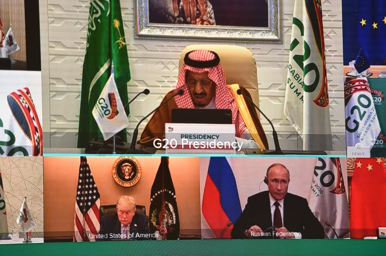 Saudi King Salman bin Abdulaziz gives an address opening the G20 summit online due to the coronavirus pandemic, with US President Donald Trump and Russian President Vladimir Putin among the leaders shown listening
