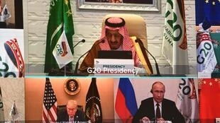 Saudi King Salman bin Abdulaziz gives an address opening the G20 summit online due to the coronavirus pandemic, with US President Donald Trump and Russian President Vladimir Putin among the leaders shown listening