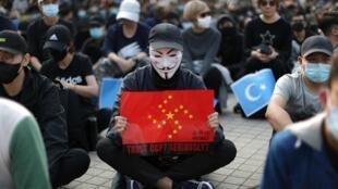 Biểu tình ở Hồng Kông phản đối Bắc Kinh đàn áp người Duy Ngô Nhĩ ở Tân Cương, Trung Quốc, ngày 22/12/2019