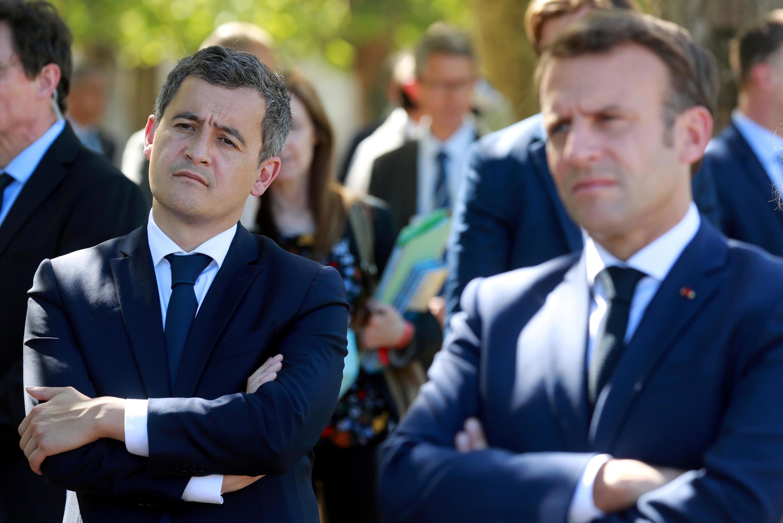 法國內政部長達馬南(左)與馬克龍
