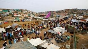 FILE PHOTO: Rohingya refugees gather at a market inside a refugee camp in Cox's Bazar, Bangladesh, March 7, 2019