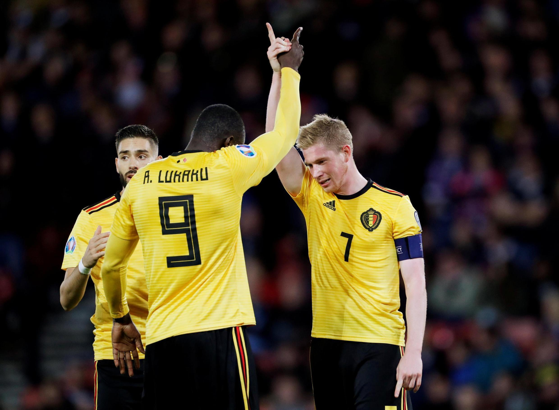Kevin De Bruyne (right) scored his 17th international goal during Belgium's 4-0 romp past Scotland.