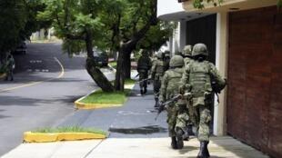Mexican soldiers patrol on a street in Zapopan, near Guadalajara City