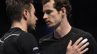 Andy Murray (right) beat Stan Wawrinka in straight sets at the end of the season championships in London.