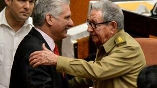 Cuban Communist Party chief Raul Castro (R) greets President Miguel Diaz-Canel at the closing of a meeting of the country's National Assembly
