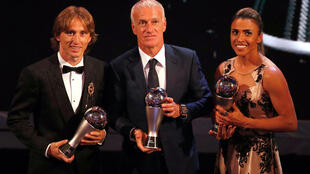 Luka Modric, Didier Deschamps and Marta pose with their awards.