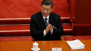 中共中央总书记习近平,5月22日在中国全国人大会议上。