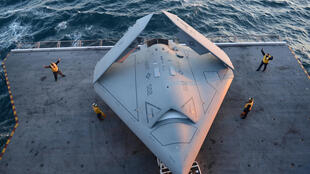 U.S._Sailors_move_a_U.S._Navy_X-47B_Unmanned_Combat_Air_System_demonstrator_aircraft_onto_an_aircraft_elevator_aboard_the_aircraft_carrier_USS_George_H.W._Bush_(CVN_77)_May_14,_2013,_in_the_Atlantic_Ocean_130514-N-FU