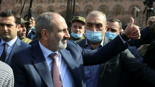 Armenian Prime Minister Nikol Pashinyan greets his supporters during a gathering in the centre of Yerevan on February 25.