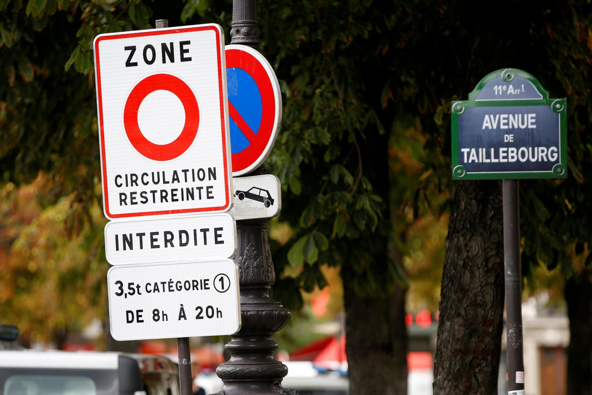 """A road sign reading """"restricted traffic area"""" is seen as part of a plan to ban the most polluting lorries and coaches from the French capital, in Paris, France, September 1, 2015."""