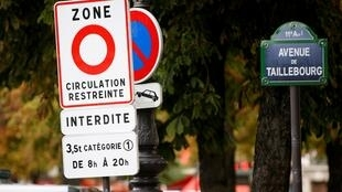 "A road sign reading ""restricted traffic area"" is seen as part of a plan to ban the most polluting lorries and coaches from the French capital, in Paris, France, September 1, 2015."