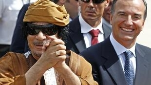 Italian FM Franco Frattini with Libya's Moamer Kadhafi in 2010