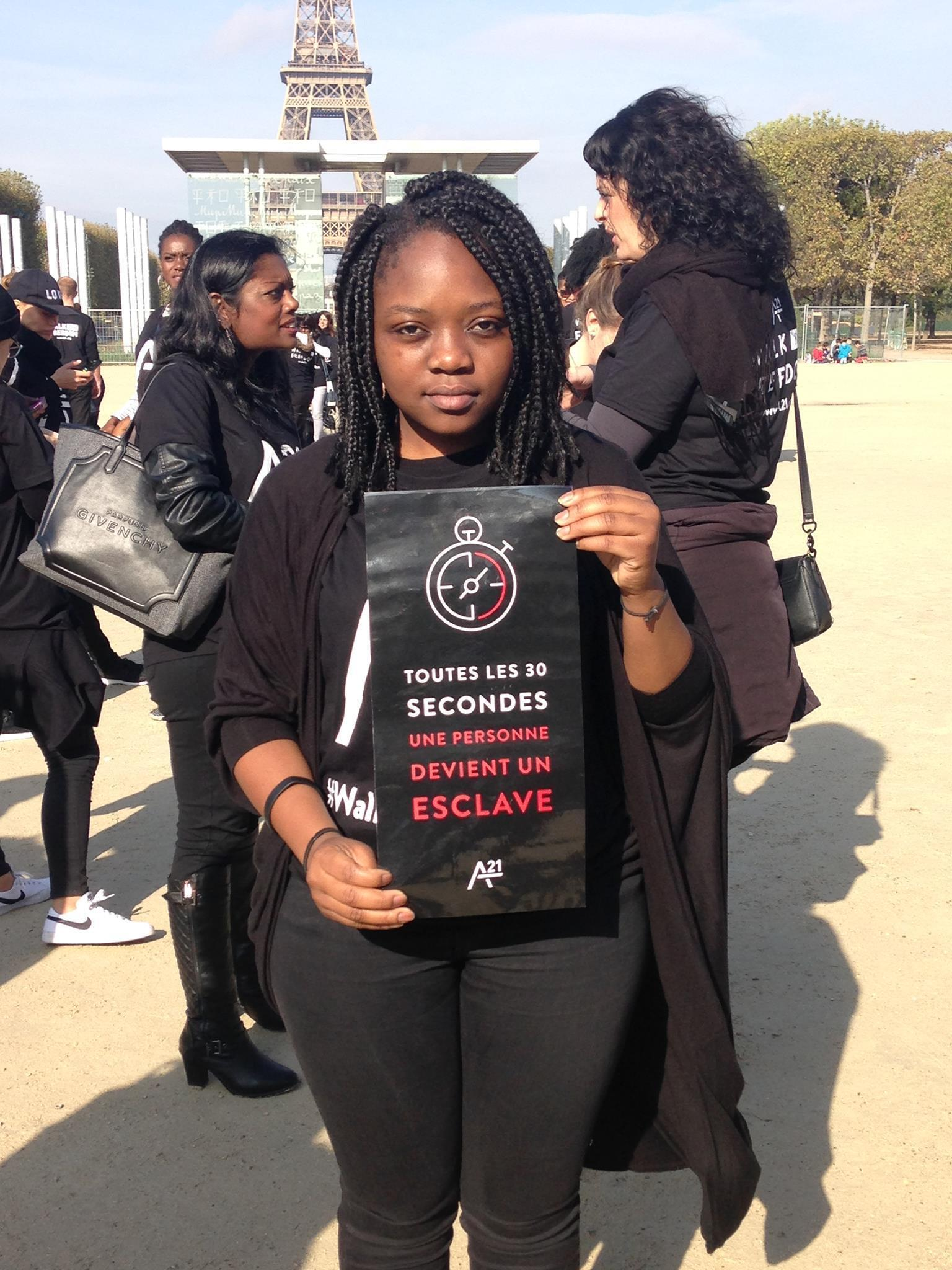 Activists dressed in black stage a silent march in Paris, 15 October to shine spotlight on human trafficking.