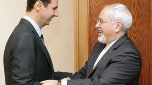 Syrian President Bashar al-Assad (L) with Iranian Foreign Minister Mohammad Javad Zarif