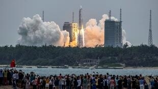 A Long March 5B rocket carrying China's Tianhe space station core module lifts off from the Wenchang Space Launch Center on April 29, 2021