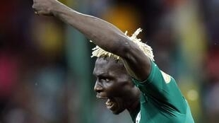 Burkina Faso's Aristide Bance celebrates scoring a penalty during their semi-final match against Ghana, 6 February, 2013