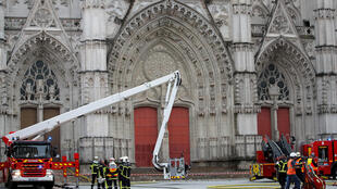 French firefighters work at the scene of a blaze at the Cathedral of Saint Pierre and Saint Paul in Nantes, France, July 18, 2020. REUTERS/Stephane Mahe
