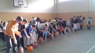 Teenagers at Alfred Sisley College in Moret-sur-Loing perform basketbeat alongside their school orchestra