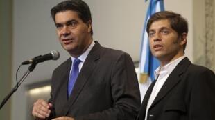 El jefe de Gabinete Jorge Capitanich y el ministro de Economía Axel Kicillof anuncian las próximas nuevas medidas, el pasado 24 de enero.