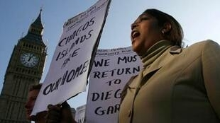 A demonstrator demanding her return to the Chagos Islands in the Diego Garcia archipelago shouts during a protest outside the Houses of Parliament in London 22 October 2008.