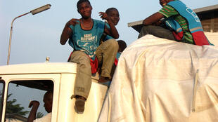 Electoral commission workers sitting atop a truck entering the Fikin counting centre, Kinshasa, 30 November